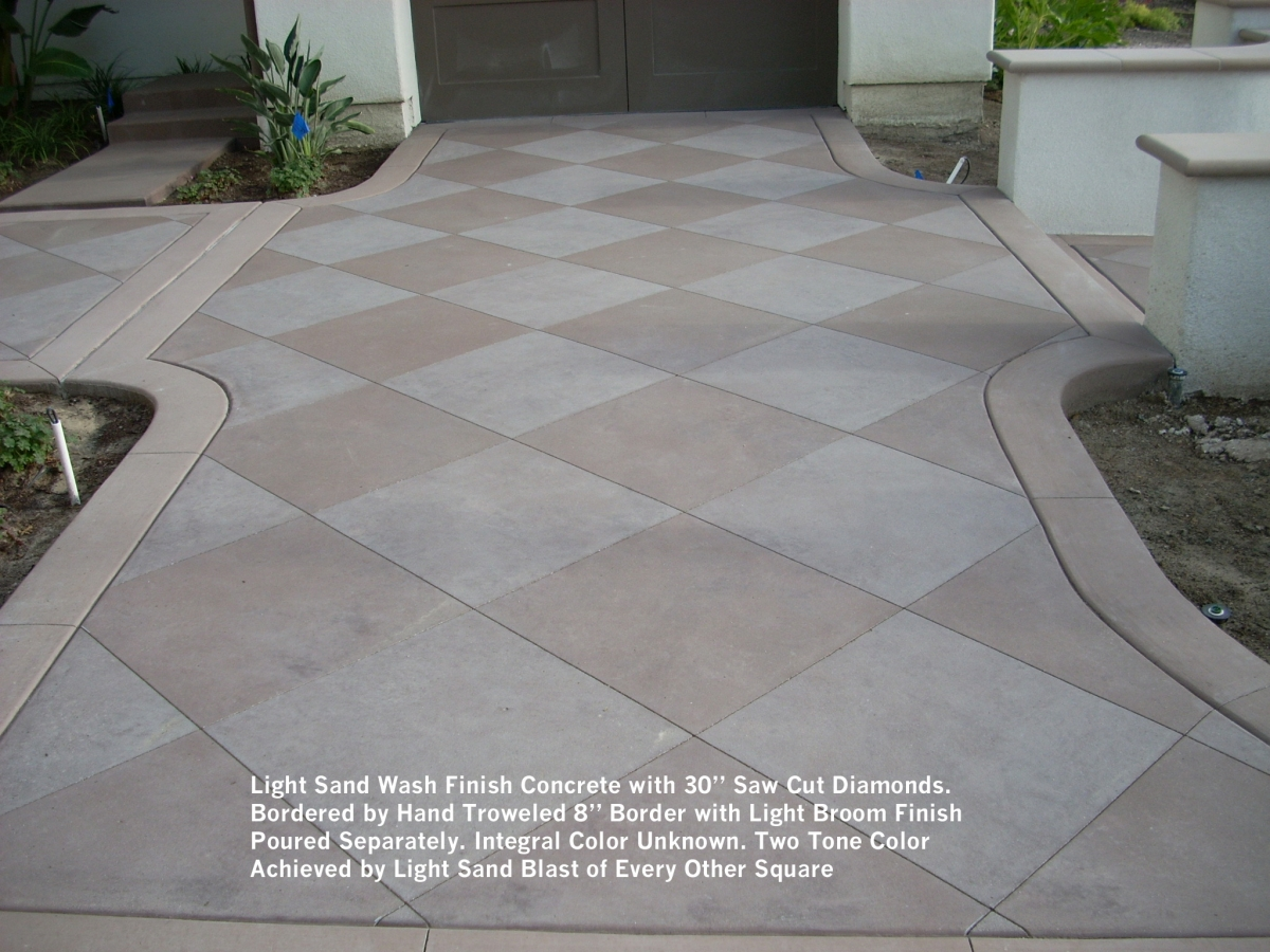 Light sand wash finish concrete withsaw cut diamonds bordered by hand troweled 8 border with light broom finish poured separately
