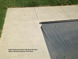 Light-Sandwash-Finish-with-Dust-On-Color-Square-Nosed-Cantilever-Pool-Deck