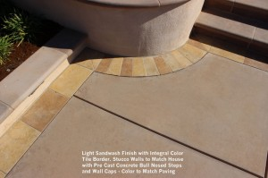 Light-Sandwash-Finish-with-Integral-Color-Tile-Border-Stucco-Walls-to-Match-House-with-Pre-Cast-Concrete-Bull-Nosed-Steps-and-Wall-Caps-Color-to-Match-Paving