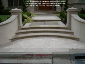 Sand-Wash-Concrete-with-Pre-Cast-Concrete-Border-and-Bull-Nosed-Step-Treads-and-Wall-Cap-Tile-Field-Stucco-Walls-wth-Pre-Cast-Concrete-Pilasters