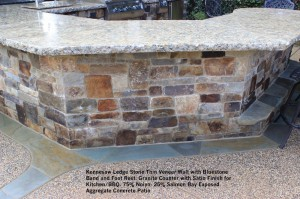 Kennesaw Ledge Stone Thin Veneer Wall with Bluestone  Band and Foot Rest. Granite Counter with Satin Finish for Kitchen_BBQ. 75% Noiyo- 25% Salmon Bay Exposed  Aggregate Concrete Patio