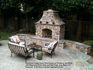 Kennesaw Ledge Stone Thin Veneer on Fireplace and Walls  with Bluestone Patio Inlay and Wall Caps. Cap Edges are  Routered. 3_16 Noiyo Exposed Aggregate Patio