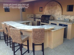Kitchen-with-Smooth-Stucco-Walls-and-Granite-Counters-and-Backsplash-Tile-Wall-Detail-Exposed-Aggregate-Patio