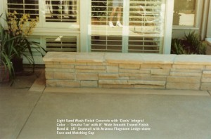 """Light Sand Wash Finish Concrete with 'Davis' Integral  Color  - 'Omaha Tan' with 8"""" Wide Smooth Trowel Finish Band &  18"""" Seatwall with Arizona Flagstone Ledge stone Face and Matching Cap"""