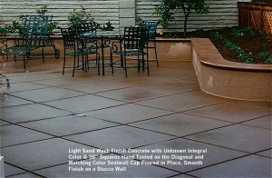 """Light Sand Wash Finish Concrete with Unknown Integral  Color & 36"""" Squares Hand Tooled on the Diagonal and  Matching Color Seatwall Cap Poured in Place, Smooth Finish on a Stucco Wall"""