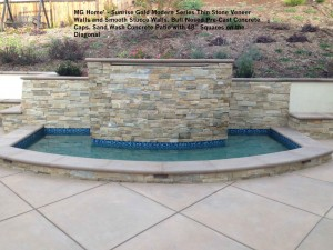 """MG Home' - Sunrise Gold Modern Series Thin Stone Veneer Walls and Smooth Stucco Walls. Bull Nosed Pre-Cast Concrete Caps. Sand Wash Concrete Patio with 48"""" Squares on the  Diagonal"""